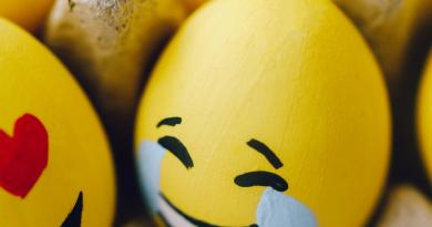 yellow smiley emoji painted eggs